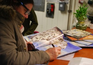 "Jackie, signing her book ""Snow Leopard"""