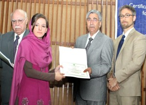 a participant receives her husbandry certificate