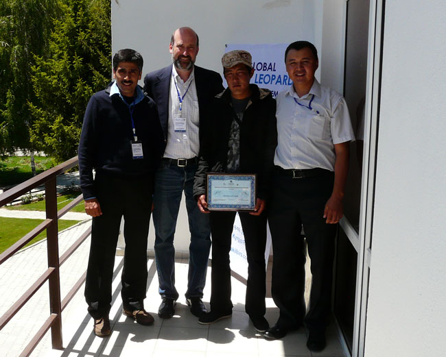 Charu Mishra, Brad Rutherford and Kuban Jumabai congratulate the Award winner