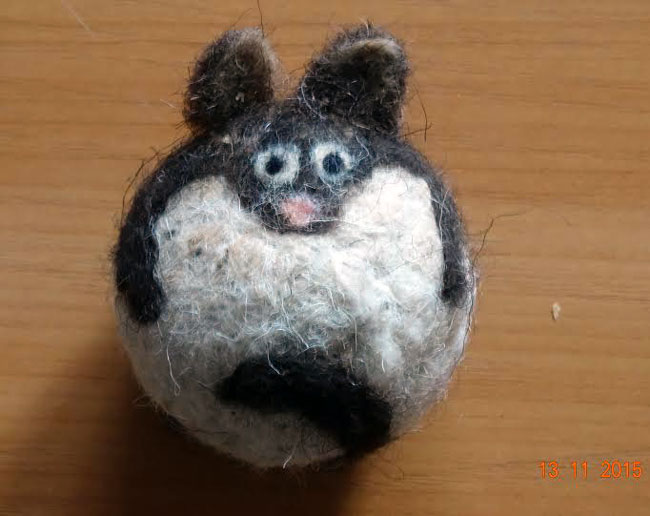 A needle-felted hedgehog, ready to provide endless fun to your cat!