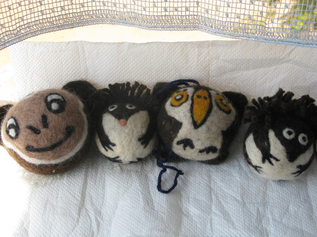 A basket of needle-felted cat toys is ready to be shipped