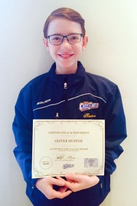 Oliver with his certificate of achievement, awarded to him by his proud supporters (click to enlarge)