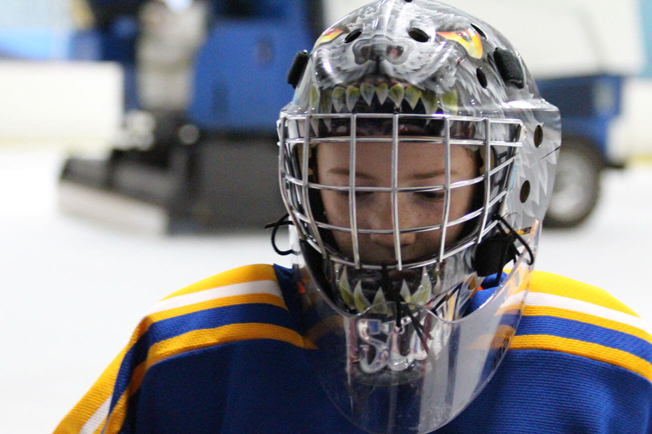 Masks are a way for goalies to express their personality. Oliver rocked a wolf last season. He hopes to have a snow leopard design next year