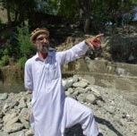 Mir Amanullah shows where the floods came from.